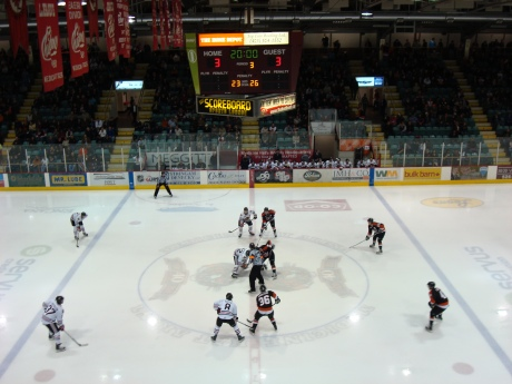 Third Period Opening Face-Off...Nice view from the Hat press box...